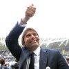 Photo - FILE - In this Sunday, May 18, 2014 file photo coach Antonio Conte greets supporters prior to a Serie A soccer match between Juventus and Cagliari at the Juventus stadium, in Turin, Italy. Former Juventus manager Antonio Conte is the new coach of Italy, after signing a two-year contract. The Italian football federation announced the news on Thursday, Aug. 14, 2014 three days after new president Carlo Tavecchio was elected. The 45-year-old Conte replaces Cesare Prandelli, who resigned, along with former FIGC president Giancarlo Abete, immediately after Italy's early elimination from the World Cup in Brazil. (AP Photo/Massimo Pinca, File)