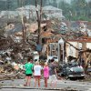 Bystanders look on at storm damage along 15th Street in Tuscaloosa, Ala., Wednesday, April 27, 2011. A strong tornado moved through the city Wednesday afternoon. (AP Photo/The Tuscaloosa News, Dusty Compton)
