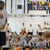 Photo - Kevin Durant goes head-to-head in a shootout with Jake Cochnauer, 8 of Minnesota, during the second day of the Kevin Durant basketball camp at Heritage Hall in Oklahoma City, Thursday, June 30, 2011.  (AP Photo/The Oklahoman, Garett Fisbeck)