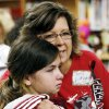 TORNADO/ AFTERMATH / RECOVERY / CHILD / CHILDREN / KIDS: Plaza Towers third grade teacher Cheryl Littlejohn hugs fourth-grader Tori Roysdon, 11, during a meet and greet with teachers and students from Plaza Towers Elementary School at Eastlake Elementary School in Oklahoma City, Thursday, May 23, 2013. Seven Plaza Towers students died when a tornado destroyed the school in Moore, Okla., on Monday. Photo by Nate Billings, The Oklahoman