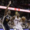 Cleveland Cavaliers\' Kyrie Irving (2) drives against Utah Jazz\'s Alec Burks (10) during the fourth quarter of an NBA basketball game Wednesday, March 6, 2013, in Cleveland. The Cavaliers won 104-101. (AP Photo/Tony Dejak)