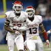 Oklahoma\'s Derrick Woods (12) and Ahmad Thomas (13) celebrate a play during the NCAA football BCS Sugar Bowl game between the University of Oklahoma Sooners (OU) and the University of Alabama Crimson Tide (UA) at the Superdome in New Orleans, La., Thursday, Jan. 2, 2014. Photo by Sarah Phipps, The Oklahoman