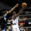 Photo - Dallas Mavericks forward Jae Crowder (9) shoots as Minnesota Timberwolves guard Ricky Rubio, left, of Spain, and forward Dante Cunningham (33) defend during the first half of an NBA basketball game, Monday, Jan. 14, 2013, in Dallas. (AP Photo/Sharon Ellman)