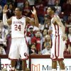 Photo - Oklahoma's Buddy Hield (24) and Cameron Clark react during an NCAA college basketball game against West Virginia in Norman, Okla., Wednesday, March 5, 2014. (AP Photo/Garett Fisbeck)