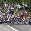 Photo - Tejay van Garderen of the U.S., center right, Alex Howes of the U.S., left, and Switzerland's Sebastien Reichenbach, right, crash during the seventh stage of the Tour de France cycling race over 234.5 kilometers (145.7 miles) with start in Epernay and finish in Nancy, France, Friday, July 11, 2014. (AP Photo/Fred Mons, Pool)