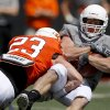 OSU\'s Brent Anderson is brought down by Zack Craig during Oklahoma State\'s spring football game at Boone Pickens Stadium in Stillwater, Okla., Saturday, April 21, 2012. Photo by Bryan Terry, The Oklahoman