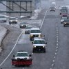 Snow began to fall in ernest just before noon Monday, Feb 25, 2013, as traffic moves along Kellogg near downtown Wichita, Kansas. National Weather Service officials in Kansas and Oklahoma issued blizzard warnings and watches through late Monday as the storm packing snow and high winds tracked eastward across West Texas toward Oklahoma, Kansas and Missouri. (AP Photo/The Wichita Eagle, Mike Hutmacher) LOCAL TV OUT; MAGS OUT; LOCAL RADIO OUT; LOCAL INTERNET OUT ORG XMIT: KSWIE101