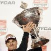 Photo - Will Power holds the Astor Cup after winning the IndyCar Series season championship Saturday, Aug. 30, 2014, at Auto Club Speedway, in Fontana, Calif. (AP Photo/Will Lester)