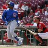 Photo - Chicago Cubs' Jorge Soler, left, watches his RBI-single hit off Cincinnati Reds relief pitcher Jumbo Diaz in the ninth inning of a baseball game, Thursday, Aug. 28, 2014, in Cincinnati. Reds catcher Devin Mesoraco, right, looks on. The Reds won 7-2. (AP Photo/David Kohl)