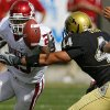Oklahoma\'s Allen Patrick (23) reaches out to grab his fumble in front of Colorado\'s Jordon Dizon (44) during the first half of the college football game between the University of Oklahoma Sooners (OU) and the University of Colorado Buffaloes (CU) at Folsom Field on Saturday, Sept. 28, 2007, in Boulder, Co. By CHRIS LANDSBERGER, The Oklahoman