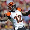 Photo -   Cincinnati Bengals wide receiver Mohamed Sanu throws a touchdown pass during the first half of an NFL football game against the Washington Redskins in Landover, Md., Sunday, Sept. 23, 2012. (AP Photo/Nick Wass)