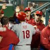 Photo -   Philadelphia Phillies' Darin Ruf (18) is congratulated by teammates after hitting a home run during the fourth inning of a baseball game against the Washington Nationals in Washington, Tuesday, Oct. 2, 2012. (AP Photo/Manuel Balce Ceneta)