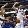 Oklahoma City\'s Nazr Mohammed (8) tries to go to the basket between Dirk Nowitzki (41) of Dallas and Peja Stojakovic (16) of Dallas during game 1 of the Western Conference Finals in the NBA basketball playoffs between the Dallas Mavericks and the Oklahoma City Thunder at American Airlines Center in Dallas, Tuesday, May 17, 2011. Photo by Bryan Terry, The Oklahoman