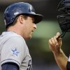 Photo - San Diego Padres' Jedd Gyorko, left, questions plate umpire Mike DiMuro after he was called out on strikes in the fourth inning of a baseball game against the Minnesota Twins, Tuesday, Aug. 5, 2014, in Minneapolis. (AP Photo/Jim Mone)