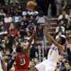 Philadelphia 76ers\' Nick Young (1) shoots over Miami Heat\'s Dwyane Wade (3) during the first half of an NBA basketball game, Saturday, Feb. 23, 2013, in Philadelphia. (AP Photo/Michael Perez)
