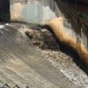 Runoff gushes down a spillway in the Arroyo Seco, which translates to \'dry creek\' or \'dry stream\' in Spanish, in Pasadena, Calif., as rain drenches the region Sunday, Jan. 31, 2016. Southern California was drenched Sunday as the latest winter storm brought downpours, heavy winds and mountain snow. A flash flood watch was issued for foothill neighborhoods underneath wildfire burn areas, triggering fears of possible mudslides and debris flows.(AP Photo/John Antczak)
