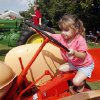Three year old Amanda Shade tries out a tractor during Septemberfest at the Governor\'s Mansion in Oklahoma City, OK, Saturday, Sept. 6, 2008. BY PAUL HELLSTERN, THE OKLAHOMAN