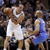 Oklahoma City\'s Derek Fisher (6) defends San Antonio\'s Manu Ginobili (20) during Game 5 of the Western Conference Finals in the NBA playoffs between the Oklahoma City Thunder and the San Antonio Spurs at the AT&T Center in San Antonio, Thursday, May 29, 2014. Photo by Sarah Phipps, The Oklahoman