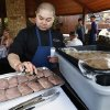 Photo -  Guest chef Vuong Nguyen prepares duck breasts for grilling at American Propane's Open Flame while fellow guest chefs Andon Whitehorn and Colin Stringer wait their turn.  <strong>STEVE SISNEY -  THE OKLAHOMAN </strong>