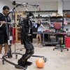 Photo - In this July 7, 2014, photo, research associates Larry Vadakedathu, left, and Qin He work with one of their RoboCup entries, a 5-foot-tall metal humanoid named THOR (Tactical Hazardous Operations Robot), in the adult-size league at the University of Pennsylvania in Philadelphia. A week after the World Cup title game in Rio de Janeiro, teams from 45 countries will face off at RoboCup about 1,200 miles away in the Brazilian coastal town of Joao Pessoa. (AP Photo/Matt Rourke)