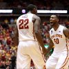 Photo - Iowa State forward Dustin Hogue and guard DeAndre Kane celebrate a blocked shot by Hogue during the second half of an NCAA college basketball game against Texas in Ames, Iowa, Tuesday, Feb. 18, 2014. Iowa State won 85-76. (AP Photo/Justin Hayworth)