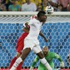 United States\' Tim Howard, right, watches as Ghana\'s Asamoah Gyan, center, goes up with United States\' Geoff Cameron for a header during the group G World Cup soccer match between Ghana and the United States at the Arena das Dunas in Natal, Brazil, Monday, June 16, 2014. (AP Photo/Petr David Josek)