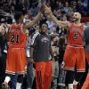 Chicago Bulls guard Jimmy Butler, left, celebrates with forward Carlos Boozer after scoring a basket, as Nate Robinson, center, watches during the second half of an NBA basketball game against the Miami Heat in Chicago on Wednesday, March 27, 2013. The Bulls won 101-97, ending the Heat\'s 27-game winning streak. (AP Photo/Nam Y. Huh)
