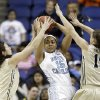 Photo - North Carolina's Allisha Gray, center, looks to pass as she is trapped by Wake Forest's Jill Brunori, left, and Millesa Calicott, right, during the first half of an NCAA college basketball game at the Atlantic Coast Conference tournament in Greensboro, N.C., Thursday, March 6, 2014. (AP Photo/Chuck Burton)