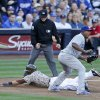 San Diego Padres\' Everth Cabrera slides into third safely as Los Angeles Dodgers third baseman Juan Uribe awaits a late throw in the first inning of the opening game of Major League baseball in the United States Sunday, March 30, 2014, in San Diego. (AP Photo/Lenny Ignelzi)