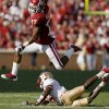 OU\'s Mossis Madu leaps over Florida State\'s Greg Reid during the second half of the college football game between the University of Oklahoma Sooners (OU) and Florida State University Seminoles (FSU) at the Gaylord Family-Oklahoma Memorial Stadium on Saturday, Sept. 11, 2010, in Norman, Okla. Photo by Bryan Terry, The Oklahoman