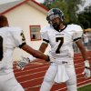 Midwest City\'s Ronnie Davis, right, celebrates with James Cudjo after Davis returned an interception for a touchdown against Del City during a high school football game in Del City, Okla., Friday, September 2, 2011. Photo by Bryan Terry, The Oklahoman