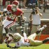 Ryan Broyles (85) slips the tackle of Greg Reid (5) during the first half of the college football game between the University of Oklahoma Sooners (OU) and Florida State University Seminoles (FSU) at the Gaylord Family-Oklahoma Memorial Stadium on Saturday, Sept. 11 2010, in Norman, Okla. Photo by Steve Sisney, The Oklahoman
