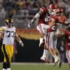 Oklahoma\'s Frank Alexander (84), Travis Lewis (28) and Jamell Fleming (32) celebrate in front of Iowa\'s Riley Reiff (77) during the Insight Bowl college football game between the University of Oklahoma (OU) Sooners and the Iowa Hawkeyes at Sun Devil Stadium in Tempe, Ariz., Friday, Dec. 30, 2011. Photo by Sarah Phipps, The Oklahoman
