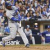 Photo - Los Angeles Dodgers' Hanley Ramirez hits a sacrifice fly that scored Dee Gordon from third base during the third inning of a baseball game Saturday, June 21, 2014, in San Diego. (AP Photo/Lenny Ignelzi)