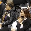 Miranda Serna\'s mother Nettie Herrera, left, and sister, Cassandra look on during the memorial service for Oklahoma State head basketball coach Kurt Budke and assistant coach Miranda Serna at Gallagher-Iba Arena on Monday, Nov. 21, 2011 in Stillwater, Okla. The two were killed in a plane crash along with former state senator Olin Branstetter and his wife Paula while on a recruiting trip in central Arkansas last Thursday. Photo by Chris Landsberger, The Oklahoman