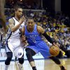 Oklahoma City\'s Russell Westbrook (0) drives to the basket as Memphis\' Courtney Lee (5) defends during Game 6 in the first round of the NBA playoffs between the Oklahoma City Thunder and the Memphis Grizzlies at FedExForum in Memphis, Tenn., Thursday, May 1, 2014. Photo by Bryan Terry, The Oklahoman