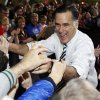 Republican presidential candidate and former Massachusetts Gov. Mitt Romney greets supporters as he campaigns at the3Iowa Events Center, in Des Moines, Sunday, Nov. 4, 2012. (AP Photo/Charles Dharapak)