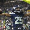 Photo - Seattle Seahawks' Richard Sherman motions to fans after intercepting in the end zone against the San Francisco 49ers in the second half of an NFL football game, Sunday, Dec. 23, 2012, in Seattle. The Seahawks won 42-13. (AP Photo/Elaine Thompson)