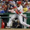 Photo - Cincinnati Reds' Billy Hamilton hits a single during the fifth inning of a baseball game against the Washington Nationals at Nationals Park Monday, May 19, 2014, in Washington. (AP Photo/Alex Brandon)