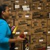A volunteer at Hoboken High School passes a wall of Meals Ready-to-Eat (MREs) intended for distribution to the public, Sunday, Nov. 4, 2012, in Hoboken, New Jersey. About 1 million homes and businesses across New Jersey are still without electricity due to Superstorm Sandy on Sunday, and officials say many of those customers may not have service restored until Wednesday. (AP Photo/ John Minchillo)
