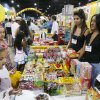 Candy samples are passed out from one of the Buy for Less booths, during the Hispanic Expo at the Transportation Building at State Fair Park in Oklahoma City, OK, Saturday, July 26, 2008. BY PAUL HELLSTERN, THE OKLAHOMAN