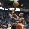 Washington Wizards\' Emeka Okafor (50) shoots as Utah Jazz\'s Al Jefferson (25) defends during the first quarter of an NBA basketball game, Wednesday, Jan. 23, 2013, in Salt Lake City. (AP Photo/Rick Bowmer)