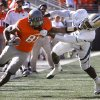 Oklahoma State\'s Justin Blackmon (81) stiff arms Baylor\'s Joe Williams (22)during a college football game between the Oklahoma State University Cowboys (OSU) and the Baylor University Bears (BU) at Boone Pickens Stadium in Stillwater, Okla., Saturday, Oct. 29, 2011. Photo by Sarah Phipps, The Oklahoman