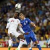 England\'s Danny Welbeck, left, and Italy\'s Federico Balzaretti jump for the ball during the Euro 2012 soccer championship quarterfinal match between England and Italy in Kiev, Ukraine, Sunday, June 24, 2012. (AP Photo/Matthias Schrader)
