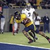 California wide receiver Keenan Allen (21) scores a touchdown in front of UCLA safety Tevin McDonald (7) during the first half of an NCAA college football game in Berkeley, Calif., Saturday, Oct. 6, 2012. (AP Photo/Tony Avelar)