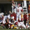 Oklahoma\'s Blake Bell (10) catches the snap during a college football game between the University of Oklahoma (OU) and Iowa State University (ISU) at Jack Trice Stadium in Ames, Iowa, Saturday, Nov. 3, 2012. Oklahoma won 35-20. Photo by Bryan Terry, The Oklahoman