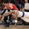 Photo - New York Knicks forward Kenyon Martin (3) dives for the ball as Chicago Bulls guard Kirk Hinrich (12) dribbles in the first half of their NBA basketball game at Madison Square Garden in New York, Wednesday, Dec. 11, 2013.  (AP Photo/Kathy Willens)