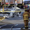 Photo - The wreckage of a small plane sits in the parking lot of shopping center Wednesday afternoon, July 30, 2014, in San Diego. Police said that one woman was killed and one hurt in the crash. (AP Photo//UT San Diego, David Brooks) NO SALES  MANDATORY CREDIT  TV OUT  MAGS OUT