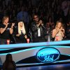 "Photo - This undated image released by Fox shows judges, from left, Keith Urban, Nicki Minaj, Randy Jackson and Mariah Carey from the singing competition series, ""American Idol,"" airing Wednesdays and Thursdays on Fox. In its 12th season, ""American Idol"" is managing to hit the right notes with sponsors if not always with fickle viewers. It has retained its status as TV's advertising leader among series and the loyalty of its biggest backers, including Ford and Coca-Cola. (AP Photo/Fox, Frank Micelotta)"