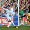 Photo - Dortmund's Pierre-Emerick Aubameyang, right, challenges for the ball with Freiburg's goalkeeper Oliver Baumann , left, during the GermanBundesliga soccer  match between SCFreiburg and Borussia Dortmund  in Freiburg,Germany,  Sunday March 9, 2014. (AP Photo/dpa,Patrick Seeger)